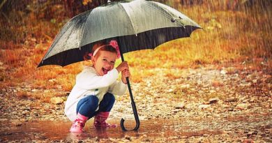 happy-baby-girl-with-an-umbrella-in-autumn-rain-outside-