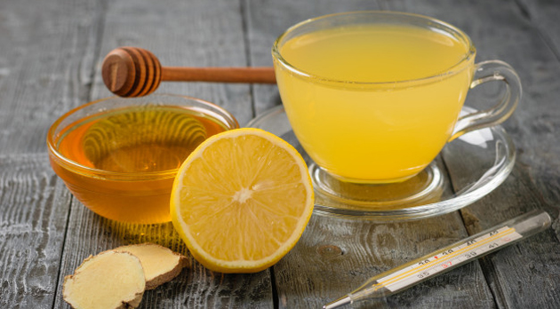 drink-ginger-root-lemon-orange-honey-cinnamon-thermometer-black-wooden-table_94064-282