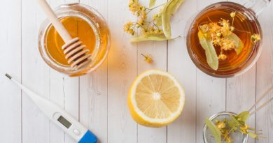 tea-with-linden-honey-lemon-healthy-food-treatment-colds-thermometer-table_78677-2918