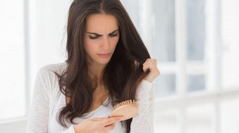 25 Jun 2013 --- Woman brushing her hair. --- Image by © Garo/phanie/Phanie Sarl/Corbis